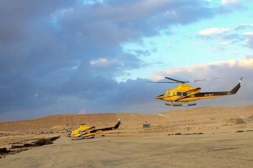 two yellow helicopter on air